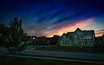 Sunsetting over residential home in suburban neighborhood