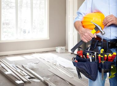 contractor with tools inside a home