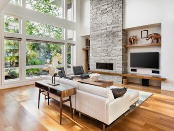 living room with picture window and fireplace