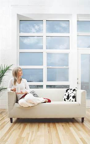 woman sitting on sofa looking out of the window