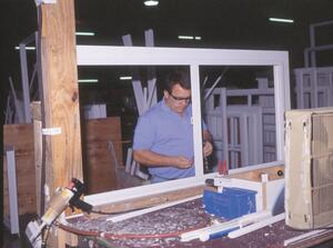Impact glass window being manufactured