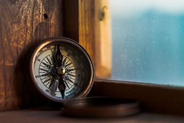 compass placed on window sill